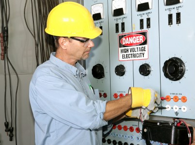 JP's Best Electric industrial electrician working with high voltage.
